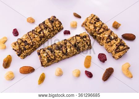 Granola Bars. A Healthy Sweet Snack. Cereal Granola Bar With Nuts And Raisins On A White Background.