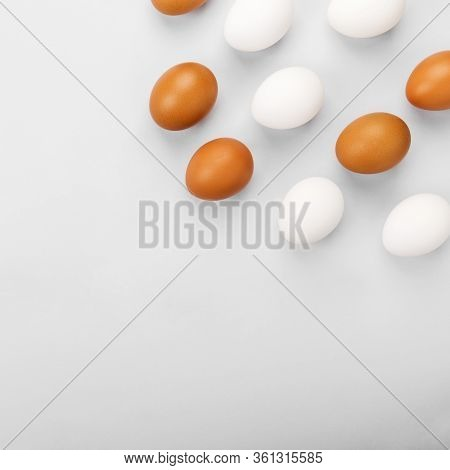 Group Of Raw Eggs White And Brown. Concept Of Diversity, Isolation, Racism, Inequality. On Gray Back