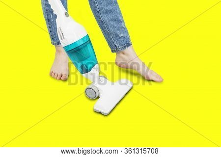 Portable Vertical Vacuum Cleaner, Girl Vacuum Cleaner, Isolated On Yellow Background