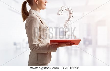 Attractive Woman Holding Open Notebook With Question Mark From Cubes. Business Consultation And Lega