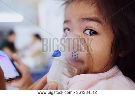 Girl Child Is Receiving A Doctor's Medication Smoke To Cure Asthma, A Lot Of Phlegm. There Is A Chan