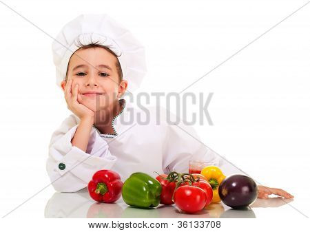 Little Happy Boy Chef In Uniform With Vegatables Lean On Hand