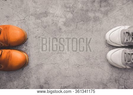 Social Distance. Top View Of Human Shoes At A Distance From Each Other On A Gray Concrete Background