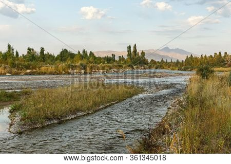 Chu River, State Border Between Kazakhstan And Kyrgyzstan. View From The Side Of Kyrgyzstan.
