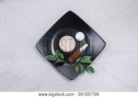Skincare Beauty Products On Light Stone Table. Hyaluronic Acid, Face Serum In Vial And Hyaluronic Ac