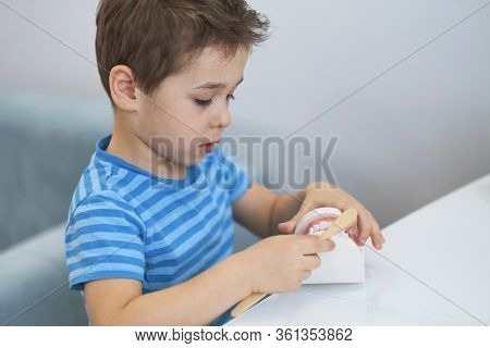 Close-up Model Of A Human Jaw With White Teeth. Little Boy Learns To Brush His Teeth With Dental Jaw