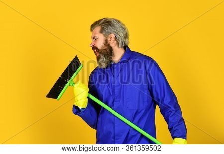 I Love Singing. Sweeping The Floor. Man Cleaner. Bearded Man Cleaning With Mop. Janitor In Gloves. H