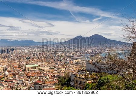 Naples, Italy, March 2018: Aerial View Of The City Center Of Naples With Mount Vesuvius On Backgroun