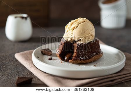 Chocolate Lava Cake With Ice Cream Served On Plate On Dark Background. Confectionery, Cafe, Restaura
