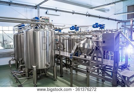 Interior Of Dairy Factory With Fermentation Tank. Technology Equipment At Dairy Farm. Sterile Produc