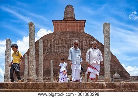 Anuradhapura, Sri Lanka - August 16, 2017: Pilgrims Leave The Jetavanaramaya Stupa After Prayers. Th