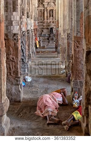 Srirangam, India - August 22, 2018: Pilgrims Resting On The Ground In Ranganathaswamy Temple. Often