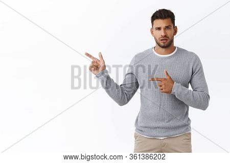 Questioned And Unsure Good-looking Clueless Boyfriend Dont Know What Happening, Pointing Left Concer