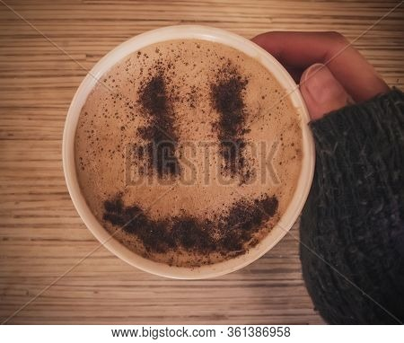 Mug Of Cappuccino With Cinnamon For Breakfast.cinnamon Powder In Form Of A Smiley Face On Coffee Foa