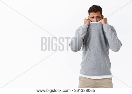 Upset Silly And Timid Young Cute Gay Feeling Offended And Lonely, Pulling Sweater Collar On Face, Fr