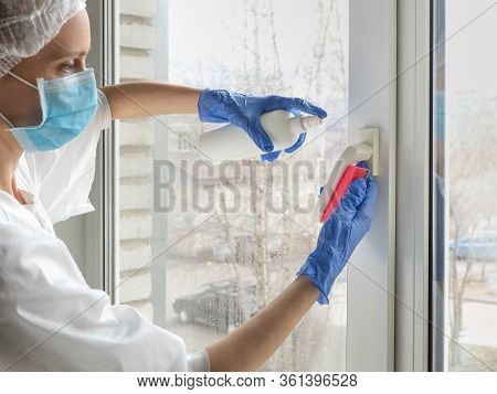 Coronavirus Disinfection. People In Making Disinfection On Windows. Doctor In Rubber Gloves Disinfec