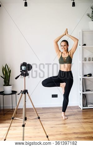 Video Tutorial, Online Training. A Young Woman Is Recording A Video Yoga Lesson At Home. She Does Yo