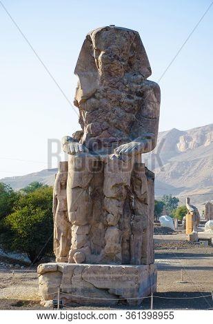 Luxor, Egypt. The Colossus Of Memnon. Massive Stone Statue Of The Pharaoh Amenhotep Iii