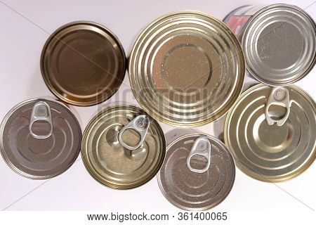 Various Canned Food In Metal Cans, Top View. Canned Goods Non Perishable Food Storage Goods