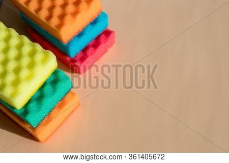 Brightly Colored Sponges On Beige Background With Copy Space.bright Colored Sponges For Washing Dish