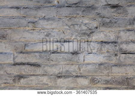 Brick Wall Texture, Background In White Oldstyle Color. Uneven Brickwork And Wall, Painted With Whit