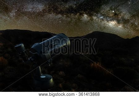 Starry Sky Above A Telescope. Mountains, Surrouded By Pine Tree Forest In The Background Night Lands