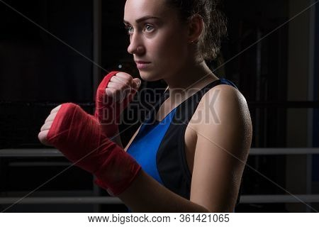 Portrait Of A Young Girl, Twenty Years Old, In Sports Uniform And Boxing Gloves, Protected From Bump