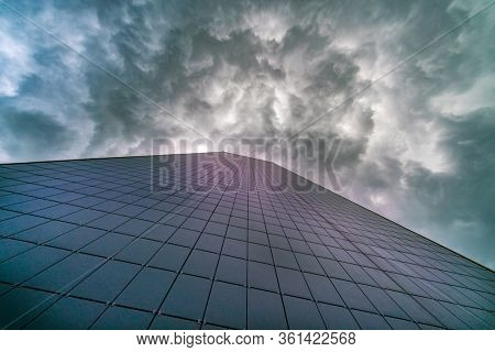 Wall building facade and dramatic stormy sky