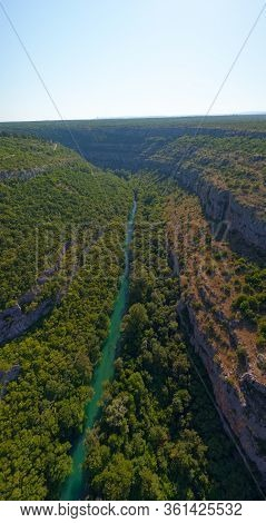 Krka River, Aerial View From The Middle Of The Canyon Located In Promina County At Dalmatian Zagora