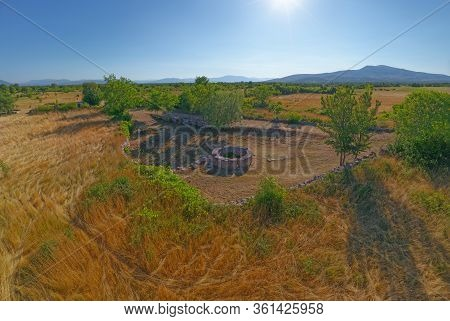 Aerial Stiched Panorama Of The Celtic Well In Dalmatian Hinterland In Promina Municipality In Croati
