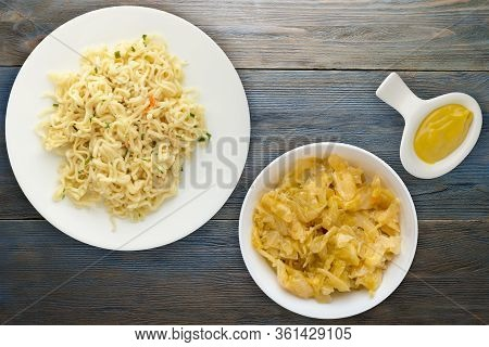 Vermicelli On A White Plate On Blue Wooden Background. Vermicelli On A Plate With Vegetarion Salad T