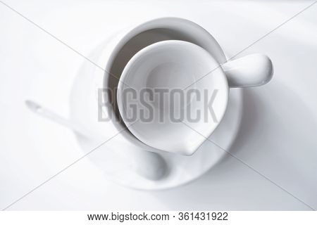 Minimal Style Tableware. Minimalism In Trendy House Interior. White Tea Cup, Plate And Saucer On A T