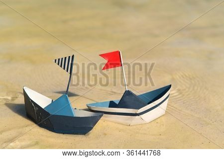 Blue paper boats floating on water