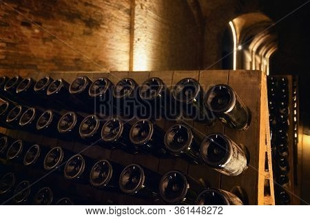 Pupitre And Bottles Inside An Underground Cellar For The Production Of Traditional Method Sparkling