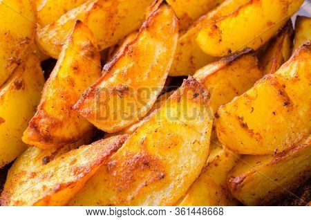 Golden Potato Wedges Fried Or Oven Baked Closeup.