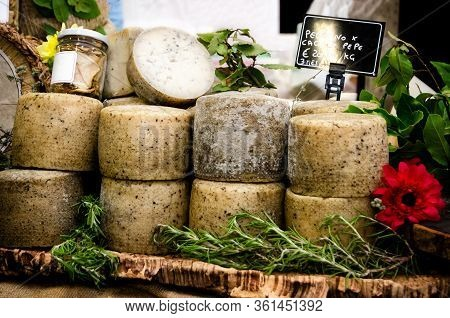 Traditional Pecorino Cheese, Ingredient For Cacio E Pepe Pasta On A Market Stall In Italy