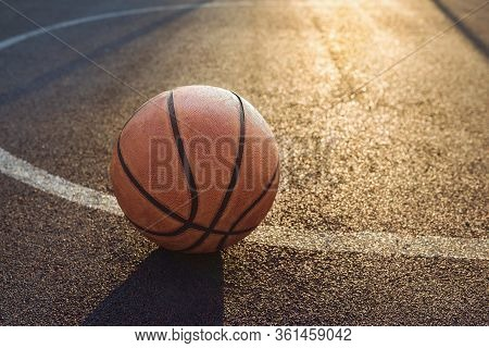 Basketball Ball On The Sports Field. Healthy Lifestyle And Sport Concepts.