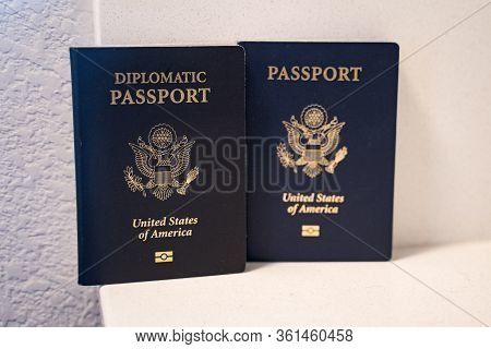 Two Passports For The United States Of America Citizens - A Diplomatic Passport (in Focus) And Regul