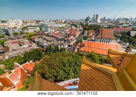 Traditional Thai Architecture With Modern Buildings And Skyscrapers In Background. Cityscape Of Bang