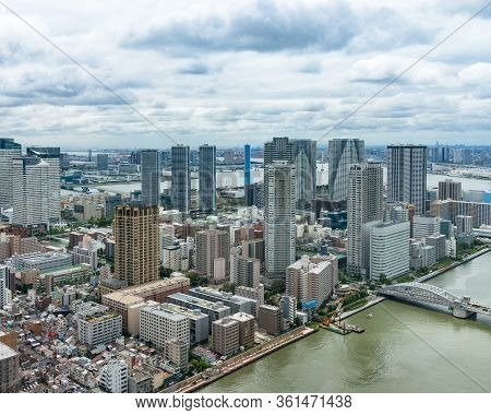 Tokyo Aerial Cityscape With Highrise Buildings And River. Japanese Urban Drone View Cityscape
