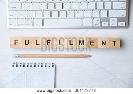 Modern Business Buzzword - Fulfilment. Top View On Wooden Table With Blocks. Top View. Close Up.
