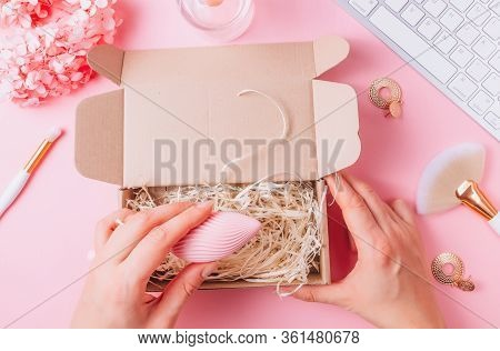 Female Pink Workplace With Keyboard, Cosmetic Brushes, Perfume Bottle, Flowers And Different Sex Toy