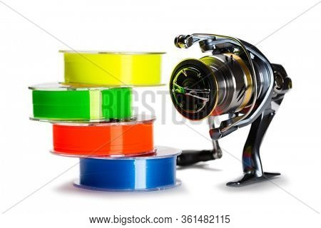 Multi-colored monofilament fishing line and fishing reel isolated on white