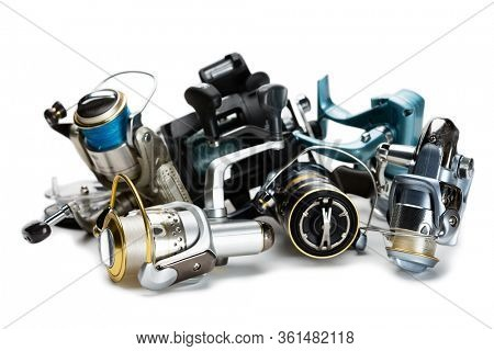 Different fishing reels isolated on white