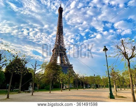 Scenic View Of The Eiffel Tower With Bright Blue Sky In Paris, France. Empty Parisian Streets During