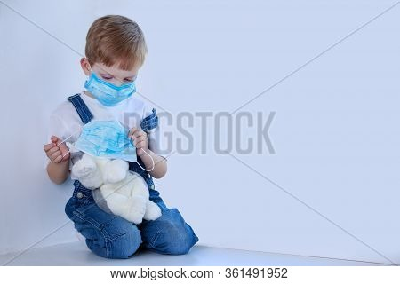 Little Masked Boy Plays With A Plush Dog