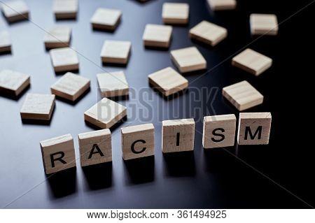 Concept Of Racism And Misunderstanding Between People, Prejudice And Discrimination. Wooden Block Wi