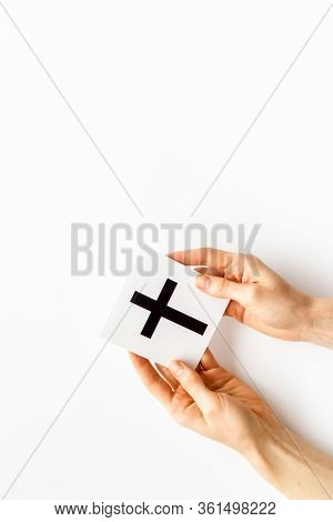 Catholic Cross Sign In Hands - Catholicism Religion Concept - On White Background Top View Copy Spac
