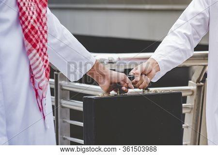 Arab Businessman Shaking Hands Together. Teamwork Business Partner Wear Muslim Dress Shake Hands Wit