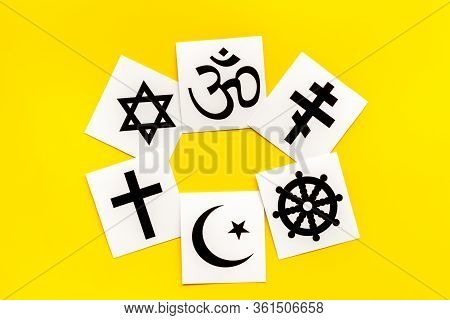 World Religions Concept. Christianity, Catholicism, Buddhism, Judaism, Islam Symbols On Yellow Backg